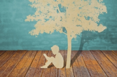 Child Studying Under Tree. Courtesy of FreeDigitalPhotos.net, by jannoon028.